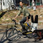 Biking Musician with Dog
